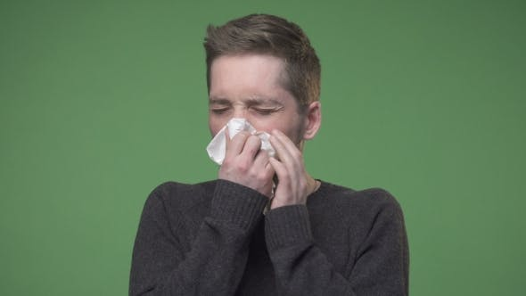 Thumbnail for Young Man Has Caught Cold and Using Handkerchief for Runny Nose