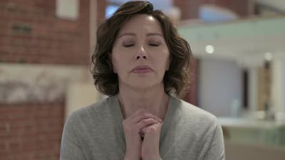 Portrait of Spiritual Old Woman Praying