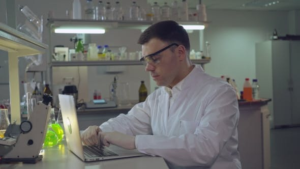 Thumbnail for Reliable Scientist Entering Research Results on Computer.