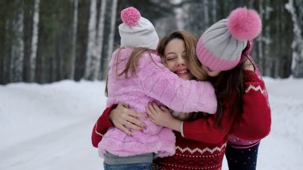 Thumbnail for Children Hugging Mother. the Child Is Happy. Mom and Daughter.