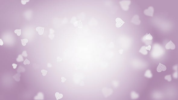 Thumbnail for Looping Video Of Glowing Pink Heart Particles