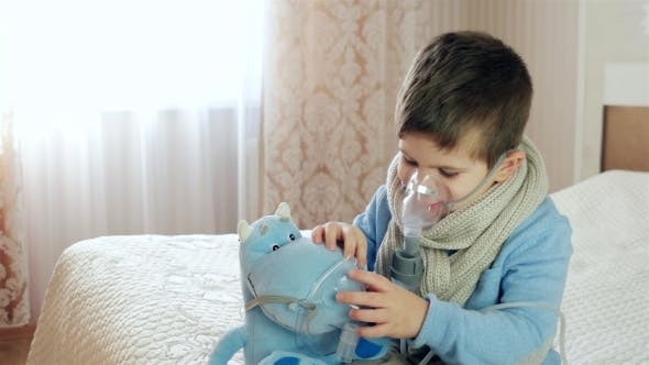 Thumbnail for Nebulizer for Inhalation, Sick Child Breathes Through Nebulizer, Baby Does Inhalation
