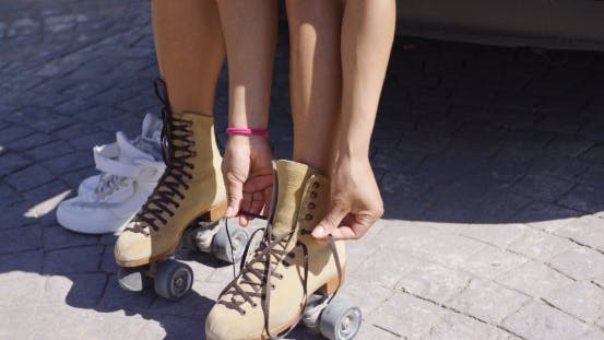 Thumbnail for Crop Female Putting on Roller Skates