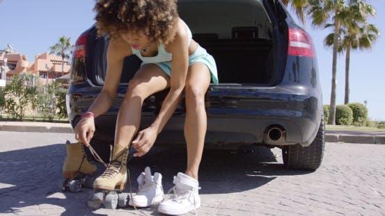 Woman Putting Roller Skates