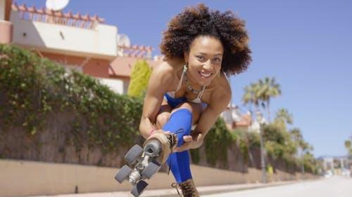 Female Showing Roller-skates