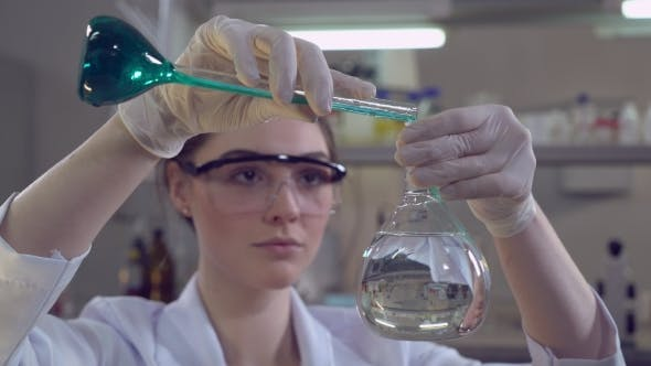 Thumbnail for Attractive Professional Scientist Carrying Out Experiments.