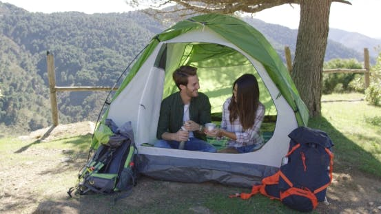 Thumbnail for Two People Having Rest in Tent