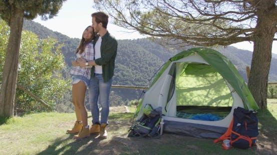 Thumbnail for Loving Couple Kissing Near Tent