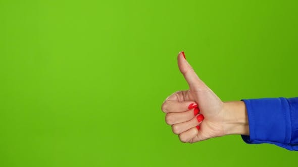 Cover Image for Female Hand, Sign Language. Thumb Up and Then Thumb Down