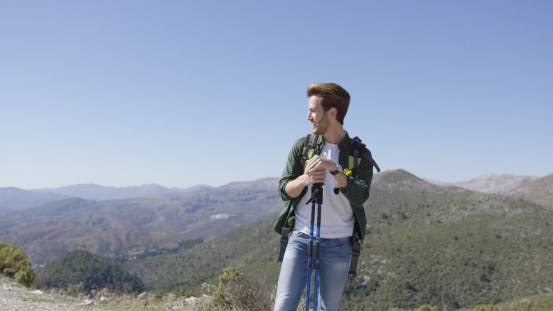 Thumbnail for Young Male with Trekking Poles Looking Away