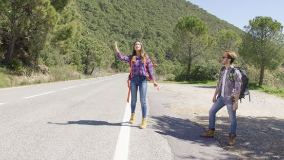 Thumbnail for Young Travellers Hitch Hiking on Road