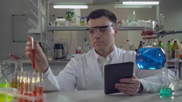 Thumbnail for Portrait Handsome Scientist Working in Laboratory.