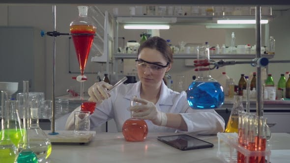 Thumbnail for Attractive Professional Scientist Holding Flask in Lab