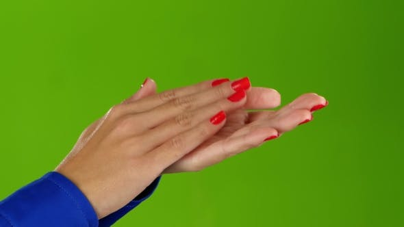 Girl Doing Applause Her Hands on a Green Screen Background