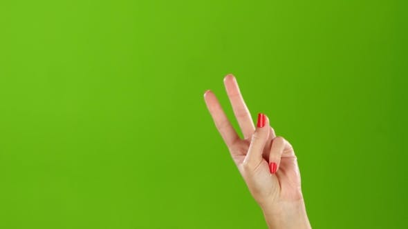 Thumbnail for Shaking Woman Hand Gesture Denoting the Peace. Green Screen Studio