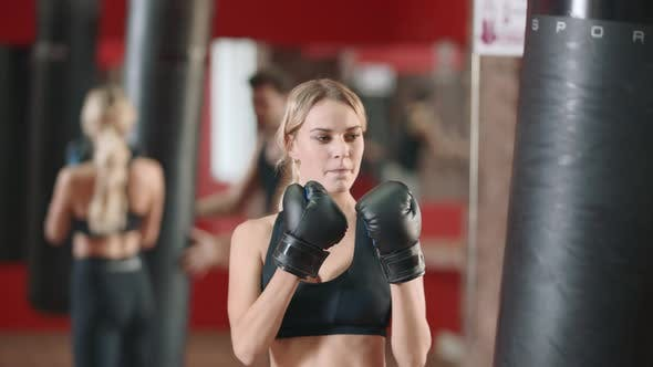Woman Boxer Training Punches on Boxing Training with Coach Together