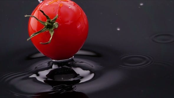 Thumbnail for Ripe Tomato Falls on the Table