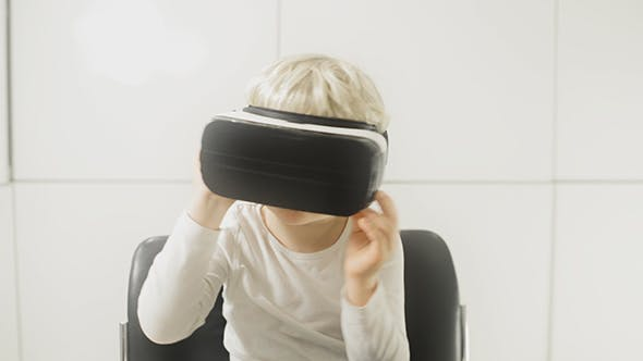 Thumbnail for Boy Watching 3D Animation Video On Virtual Reality Glasses
