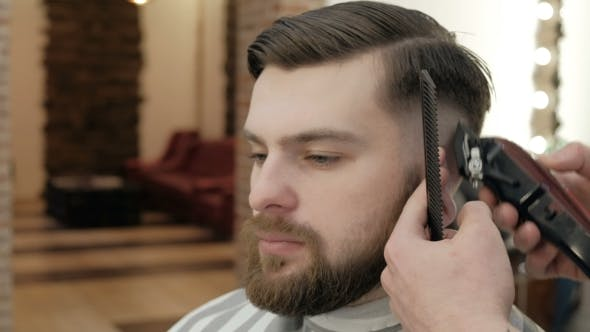 Thumbnail for Master Makes Beards Correction in Barbershop Salon