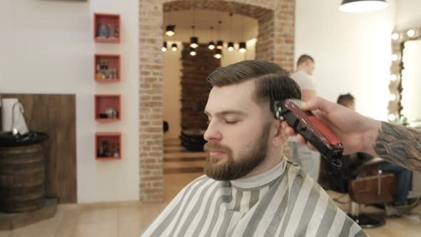 Barber Working with Electric Razor