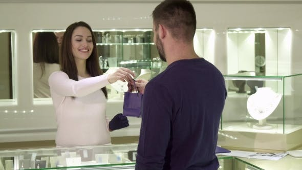 Thumbnail for Man Buys Jewelry at the Boutique