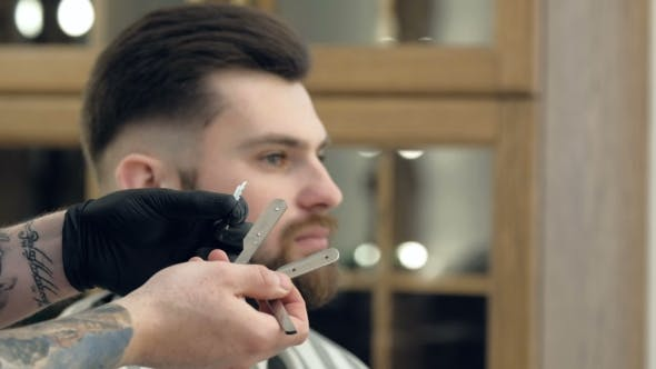 Thumbnail for Portrait of Attractive Young Man Getting Trendy Haircut. Male Hairdresser Serving Client