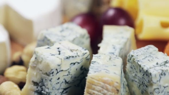 Thumbnail for Cheese Platter with Nuts and Grapes on the Table