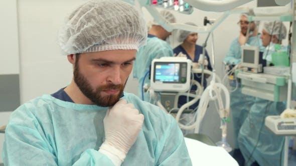 Thumbnail for Surgeon Touches His Beard