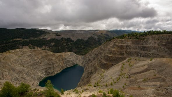 Thumbnail for Clouds Rolling Over Old Mine with Lake