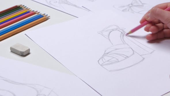 Thumbnail for Designer Draws Sketches of Fashionable Shoes and Decorate in Pink.