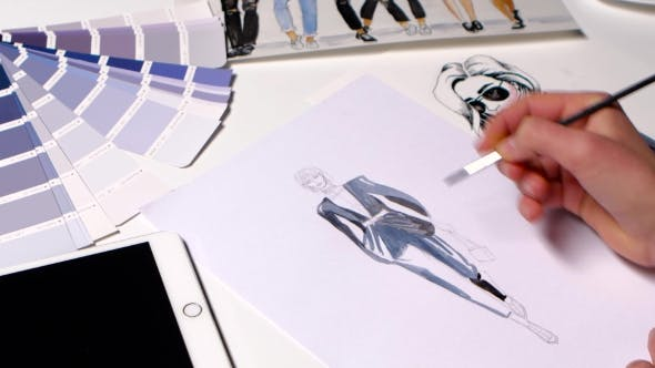 Thumbnail for Fashion Designer Gets Brush Paint on Sketch of the Dress.