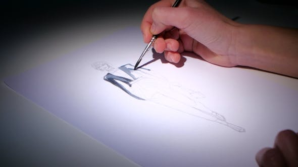 Thumbnail for Fashion Designers Put a Brush To Paint the Sketch of Fashionable Dress.