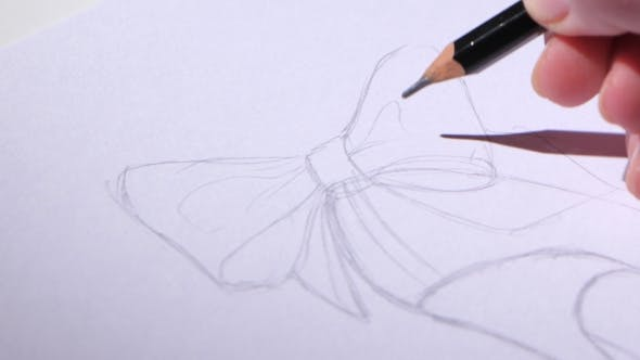 Thumbnail for Designer Shoes Sits in the Workplace and Create a Pencil Sketch.