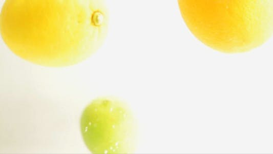 Thumbnail for Citrus Fruits Are Dropped Into Water
