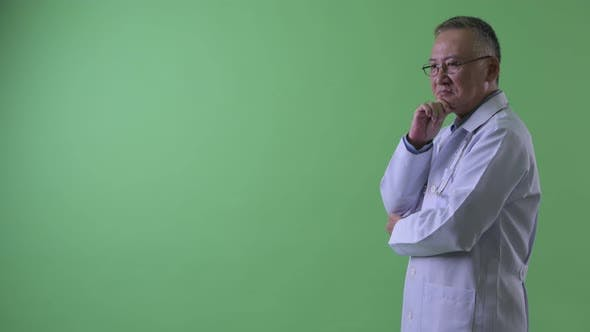 Thumbnail for Profile View of Happy Mature Japanese Man Doctor Thinking