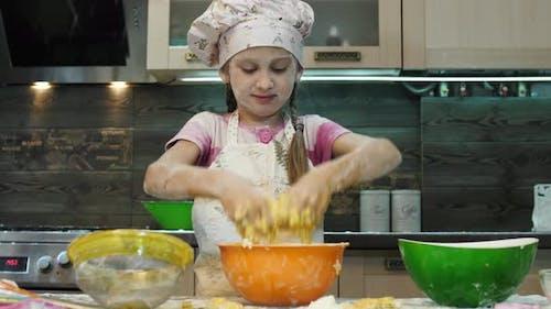 Girl mixing dough ingredients