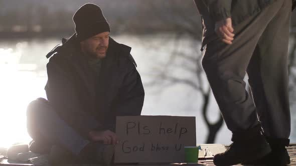 Thumbnail for Male Begging for Money with Cardboard Sign