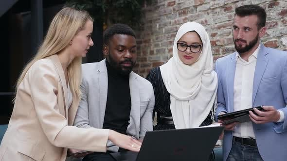 Thumbnail for Multiracial Business Colleagues which Watching on the Computer's Screen