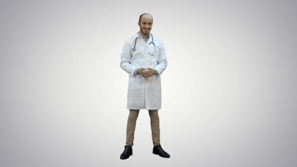 Thumbnail for Smiling Doctor Happily Looking at the Camera on White Background.