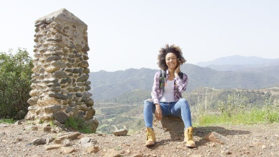 Thumbnail for Smiling Young Woman on Mountain