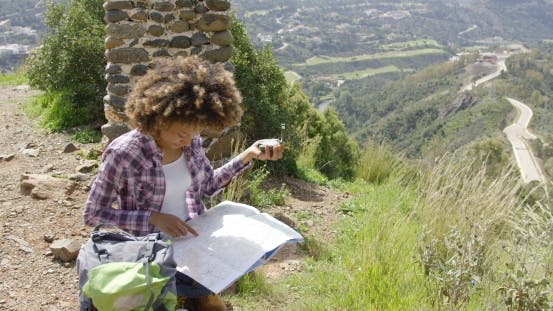 Thumbnail for Female Tourist with Map and Compass