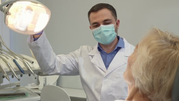 Thumbnail for Dentist Begins Check Up of Female Patient