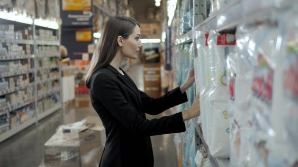 Woman Buys Diapers at the Supermarket