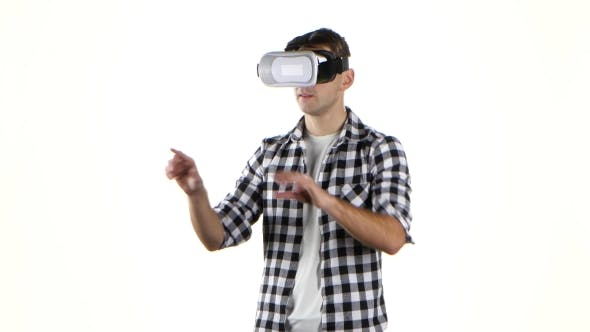 Thumbnail for Man Works with Files in Virtual Reality Glasses. Hand Movement