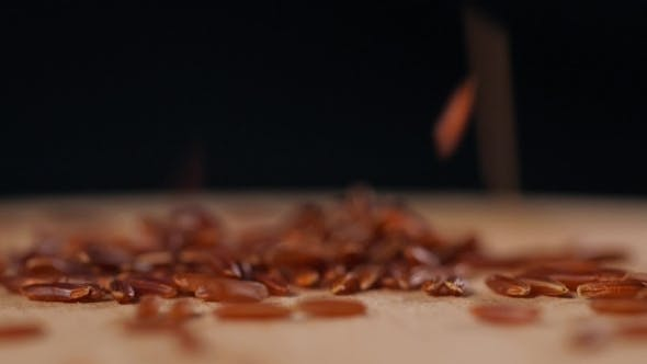 Thumbnail for Heap of Red Rice on Wooden Background  Pouring Down