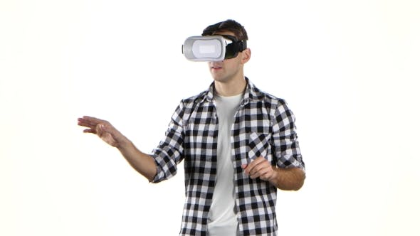 Thumbnail for In Virtual Reality Glasses Man Viewing Information, Flips Through Slides