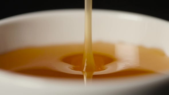 Thumbnail for Pouring Honey on Black Background