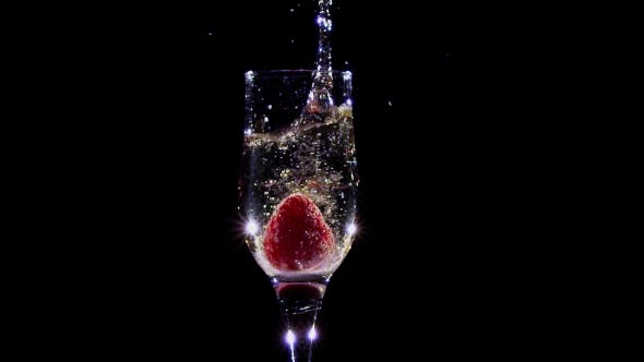 Thumbnail for Fresh Strawberries Falling in Glass with Champagne Wine.