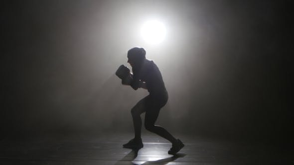 Thumbnail for Champion Kickboxer Smoke Evades Counter Punches. Silhouette. Black Background . Side View