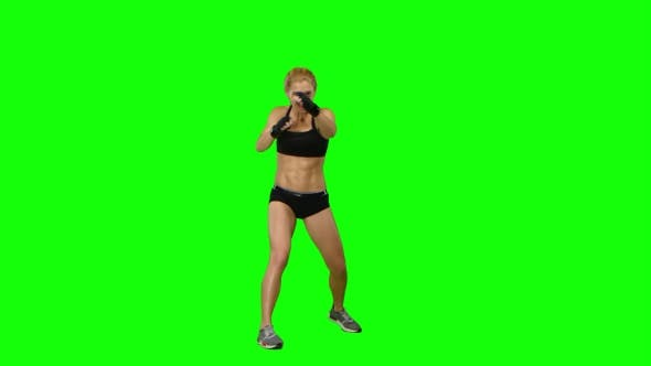 Thumbnail for Girl Boxer Sends Frequent Blows To the Enemy. Green Screen